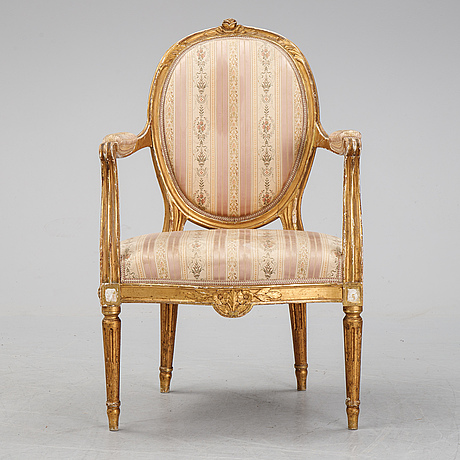 A gustavian style armchair, early 20th century.