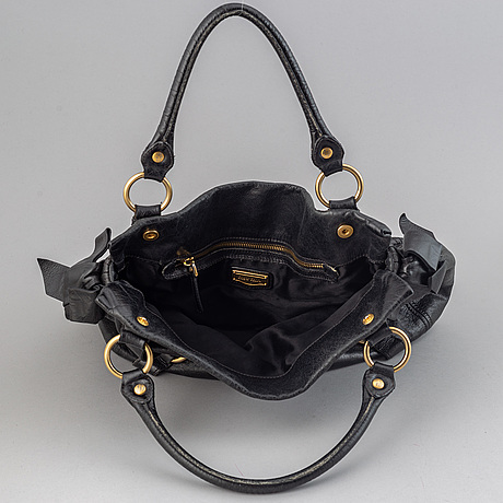 Miu miu, a leather bag.