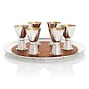 Tapio wirkkala, a set of six silver beakers on a teak and silver tray, kultakeskus, hämeenlinna 1960-1975.
