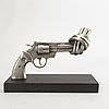 Carl-fredrik reuterswärd/ the non-violence project foundation, a signed and numbered sculpture 55/150 in humanium metal.