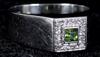 Ring, vitguld, briljanter samt grön sten. tot vikt 4 gram.
