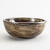 A ceramic bowl by åke holm, signed.