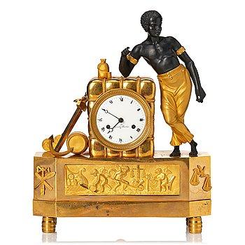 109. A Swedish Empire mantel clock by G. Undén.