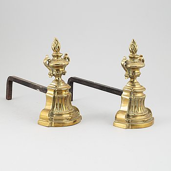 A pair of 19th century empire-style andirons.