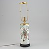 A famille rose figural hat stand, turned into a table lamp, qing dynasty, 19th century.