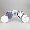 A 24 pcs bone china service from flux stoke on trent, different motives and designers, designed in 2012. england.