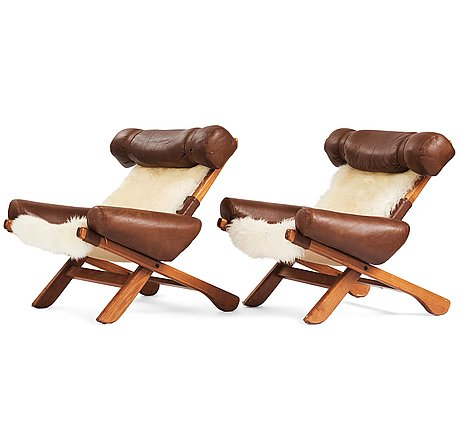 A pair of scandinavian easy chairs, 1960's.