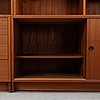 A 1960's teak shelving system by børge mogensen in three sectons for karl andersson & sons.