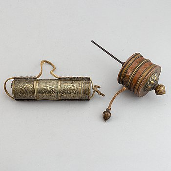 A Tibetan prayer roll and a metal roll with compartments with prayer rolls, 19th Century.