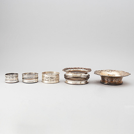 Five silver plated coasters.