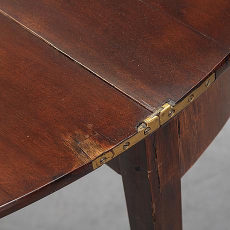A mahogany table, circa 1900.