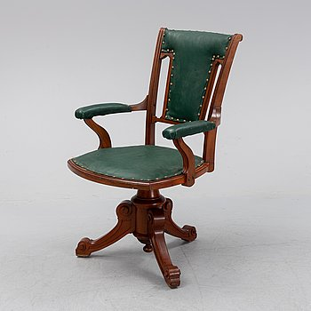 A early 20th century desk chair.