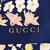 Gucci, a silk scarf.