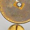 A pair of model 2539 brass candlesticks, for firma svenskt tenn, designed ca 1949-50.