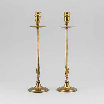 A pair of model 2539 brass candlesticks, for Firma Svenskt Tenn, designed ca 1949-50.