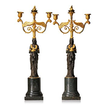 114. A pair of two light empire candelabra.