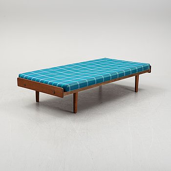A model G19 stained oak daybed by Ejvind A. Johansson for FDB furniture.