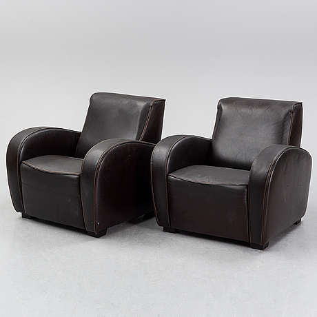 A pair of italian leather armchairs from  industria divani e poltrone, 21st-century.