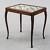 An oak table with glazed tiles by  anna-lisa thomson, s.t erik, dated 1931.