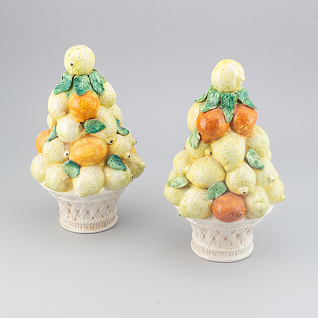A pair of capodimonte faience table decorations, italy, second half of the 20th century.