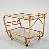 A second half of the 20th century rattan drinks trolley.