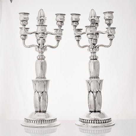 Georg jensen, a pair of six lights silver candelabra, copenhagen 1920, design nr 38.