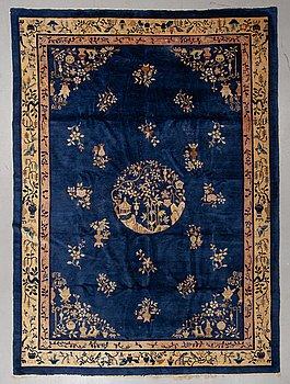A carpet, a semi-antique/old China, ca 329-333,5 x 239,5-243,5 cm.
