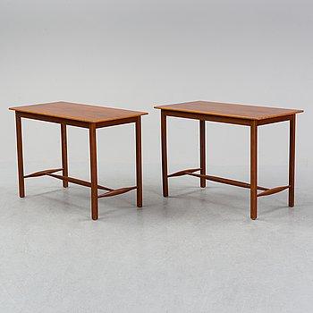 A pair of model 1106 walnut  side tables by Josef Frank for Firma Svenskt Tenn.