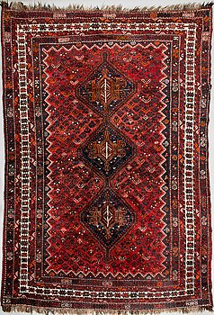 A oriental carpet. Circa 325x220 cm.