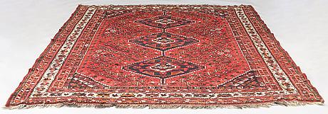 A oriental  carpet. ca 220x320 cm.