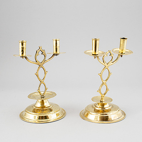 "A pair of brass candelabra for two candles ""blekingestakar and a pair of brass cups, 1800/1900."