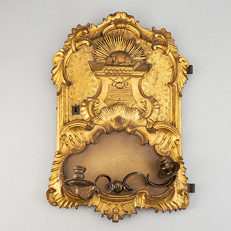 An 18th century  rococo wall sconce for two candles.