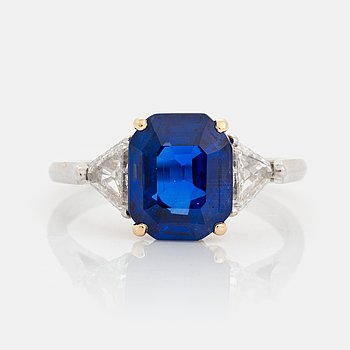 435. A platinum and 18K gold ring set with a faceted sapphire.