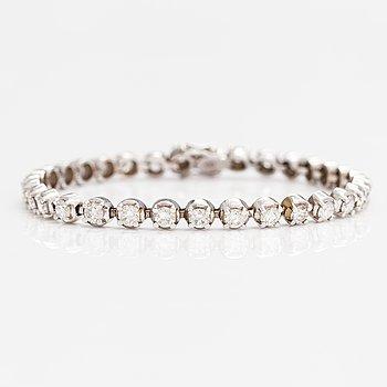 Rannekoru, 14K valkokultaa, timantteja n. 5.60 ct yht. FaberArt Helsinki.