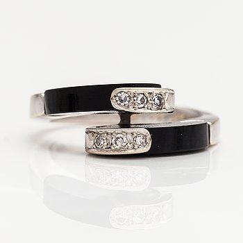 Ring, 14K vitguld, diamanter ca 0.06 ct tot och onyx. Importstämplat Tillander, Helsingfors 1974.
