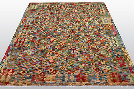 A carpet, kilim, ca 245 x 175 cm.