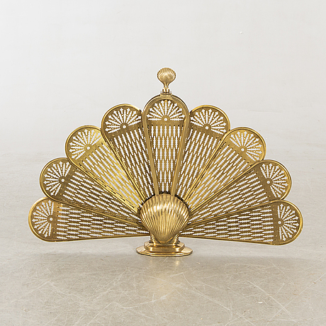 A brass fire screen later part of the 20th century.