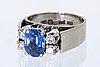 Ring 18k whitegold 1 sapphire approx 8 x 5 mm 4 brilliant-cut diamonds approx 0,30 ct, atelier ajour stockholm 1980.