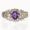 Ring 14k whitegold 1 pink sapphire approx 5 x 3 mm and brilliant-cut diamonds approx 0,25 ct.