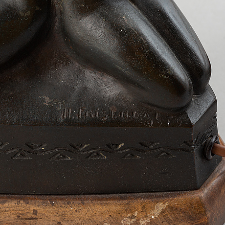 Halvar frisendahl, a bronze table lamp, signed and dated 1919.