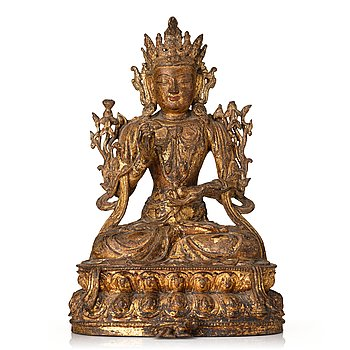 851. A gold lacquered bronze figure of Bodhisattva, Ming dynasty, mid 15th Century.