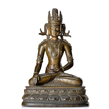 850. A bronze figure of a crowned buddha, Tibet, 14th Century.
