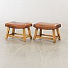 A pair of leather stools 21st century.