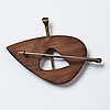 Vivianna torun bülow-hübe, a wooden and brass brooch, executed in her own workshop, stockholm ca 1948-52.