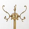 A brass coat hanger alter part of the 20th century.