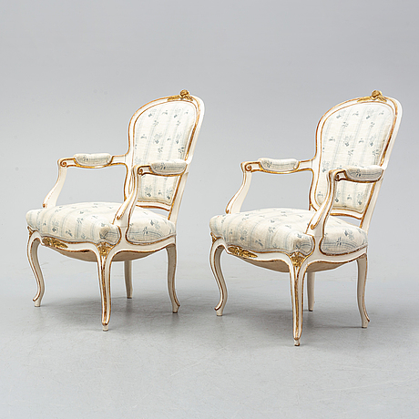 A pair of rococo style armchairs, first half of the 20th century.