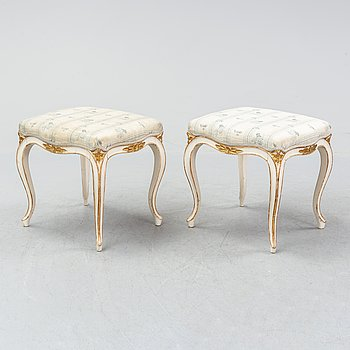 A pair of rococo style stools. First half of the 20th Century.