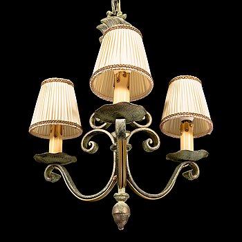 A 1930s three-light iron chandelier.
