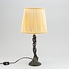 Halvar frisendahl, a patinated bronze table lamp, signed and dated 1919.