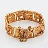 A jorma laine bracelet in gilded bronze.